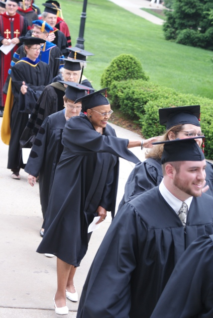 Graduates and faculty process toward the 2010 Commencement ceremony